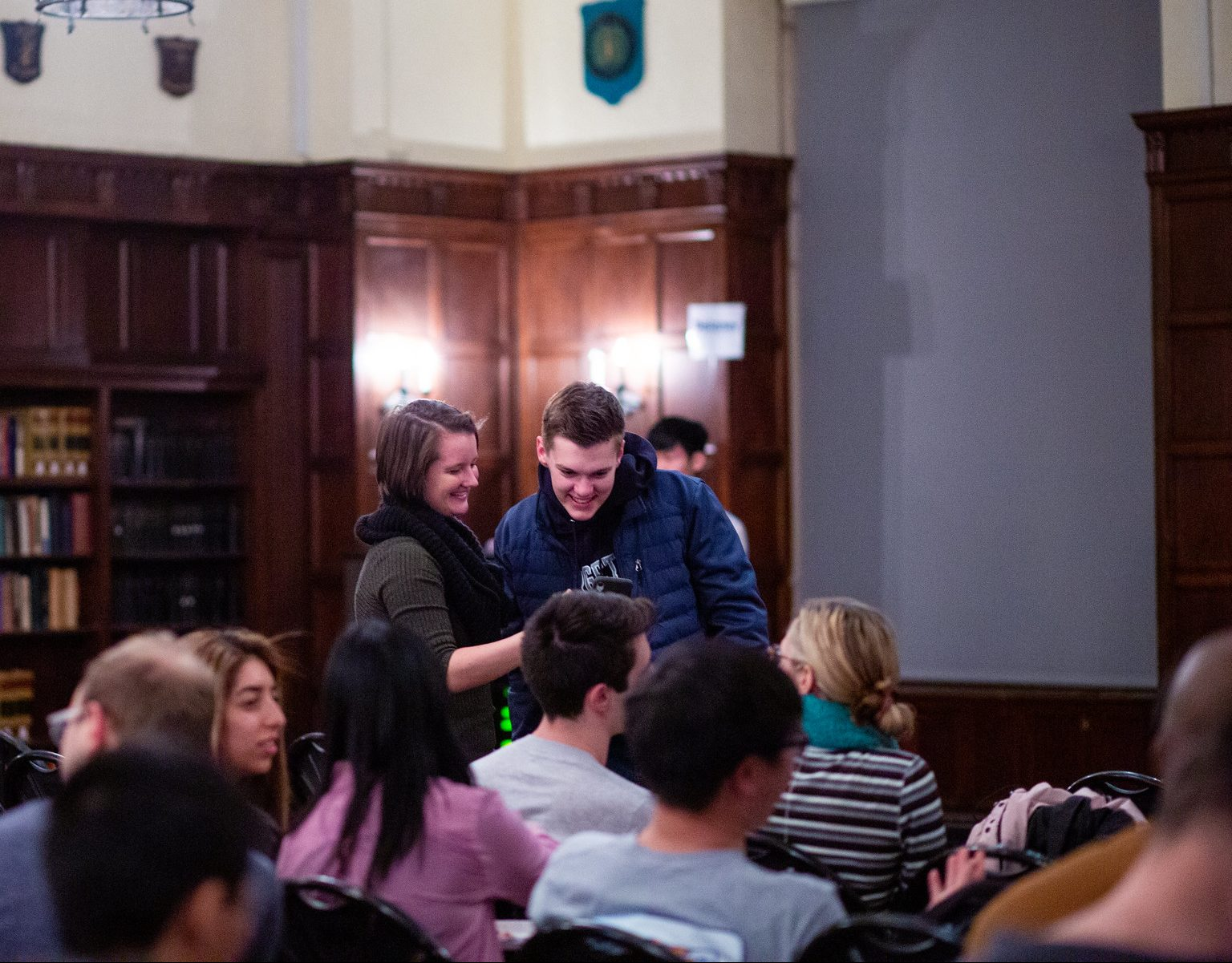 Students in a conversation at an event
