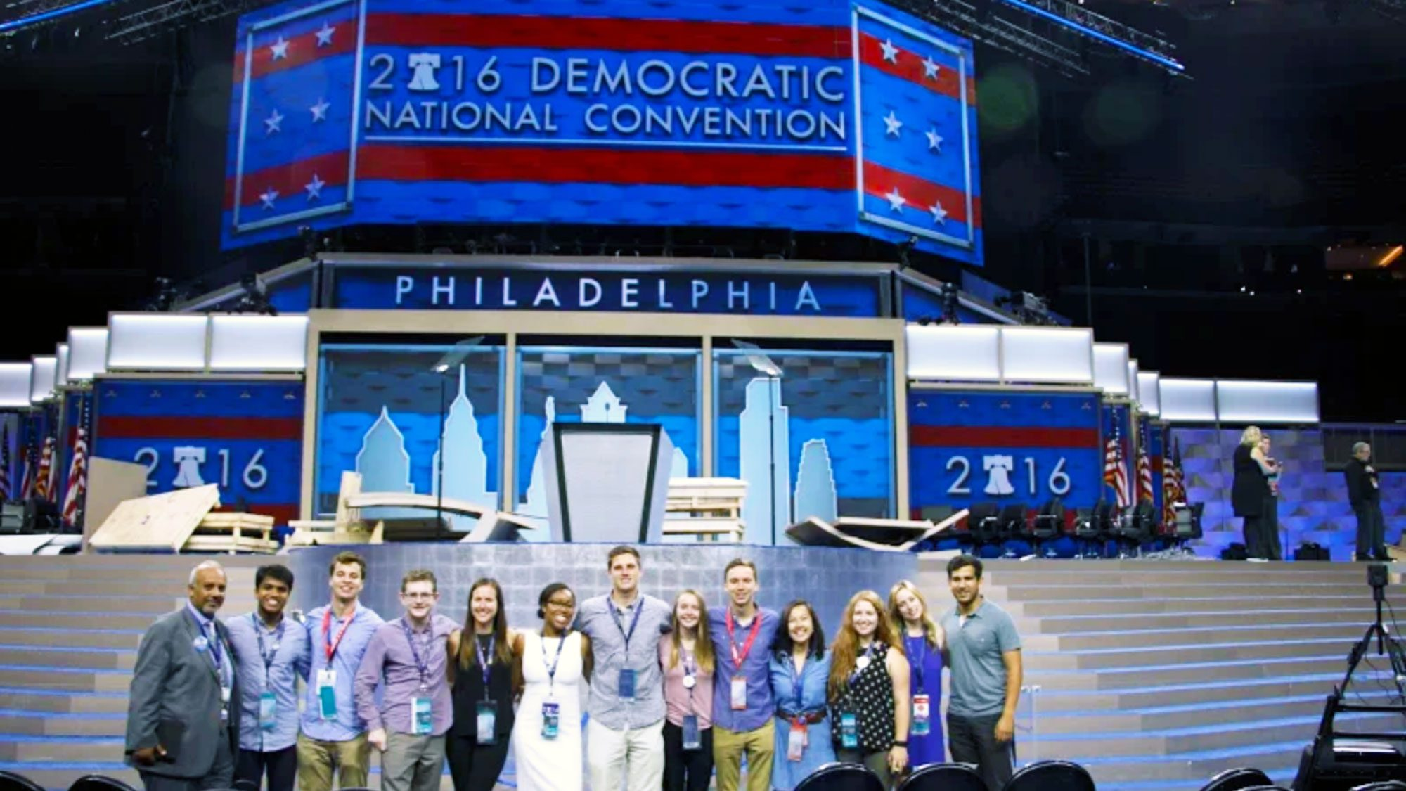 Hoyas at the DNC - stadning together at the front of the stage in Philly
